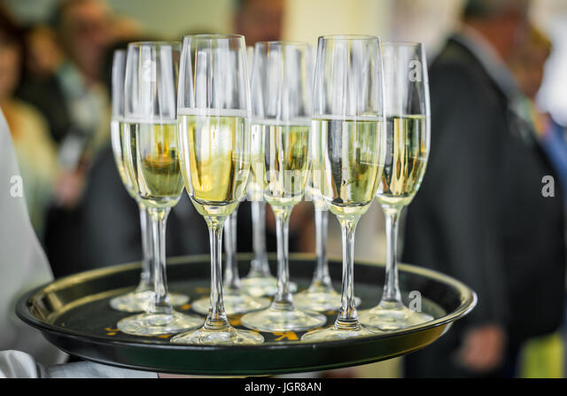 Champagne on a tray - Stock Image