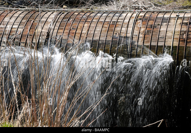 Penstock stock photos penstock stock images alamy for Leaky pipe carries more water