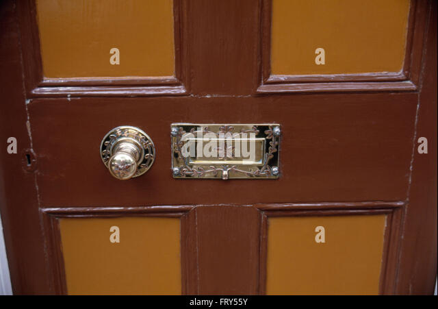 front door knob. Close-up Of A Brown Painted Front Door With Brass Knob And Letterbox