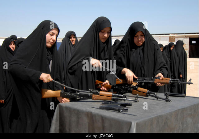Iraqi female recruits disassemble AK-47 assault rifles during weapons training. - Stock Image