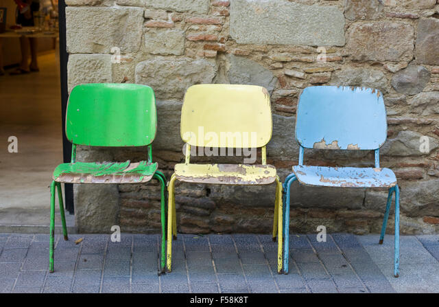 Chipped Paint On Old Colorful Wooden Chairs The Street