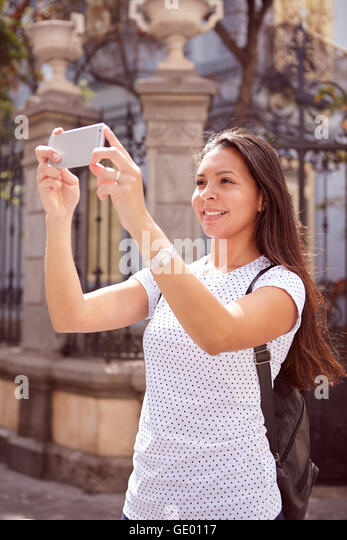 how to hold a phone while taking a picture
