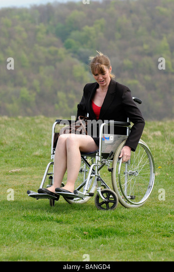 Smiling carer pushing an old man in a wheelchair stock photo image - Age Uk Wheelchair Stock Photos Amp Age Uk Wheelchair Stock