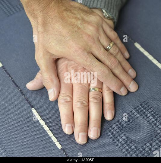 two gay men hold their hands with wedding rings april 14 2016 - Gay Mens Wedding Rings