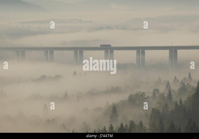 Viaduct on Sunrise with morning mist in mountains of Croatia - Stock Image
