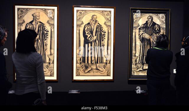25th Oct, 2015. Visitors Look At Woodcuts Of Jan Hus