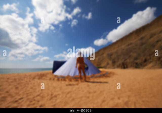 Blurred view of conical tent and sunbathing girl on summer beach with cloudy blue sky. & Conical Tent Stock Photos u0026 Conical Tent Stock Images - Alamy