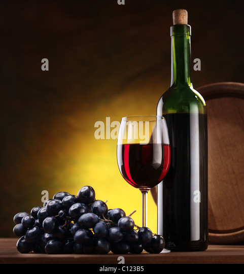 stacked oak barrels maturing red wine. still life with wine bottle glass and oak barrels stock image stacked maturing red