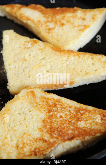 French Toast Or Eggy Bread Frying In A Pan Stock Image