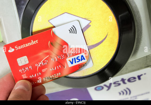 Santander visa card stock photos santander visa card stock images contactless santander visa card being used for travel payment at london underground station stock reheart Gallery