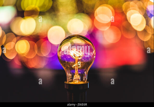 Hanging lighbulb at a Christmas market. - Stock Image