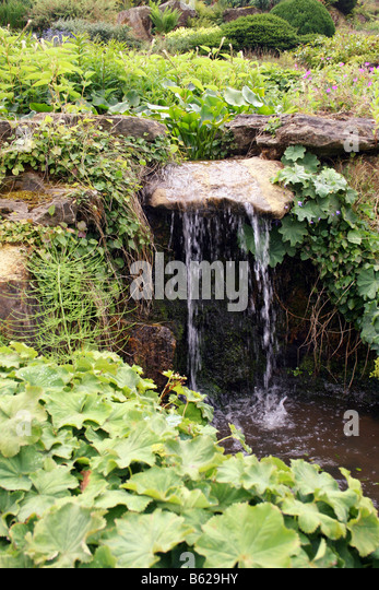 Garden water feature small waterfall stock photos garden for Small garden water features
