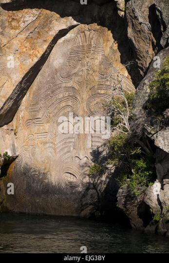 Maori rock carving stock photos