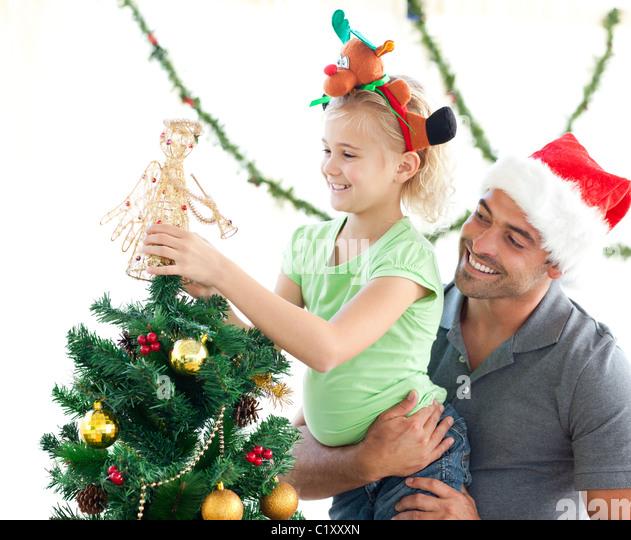People Decorating A Christmas Tree christmas tree decoration angel stock photos & christmas tree