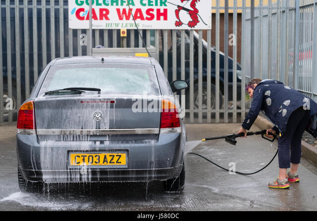 Car wash uk stock photos car wash uk stock images alamy a middle aged woman power washing cleaning her saloon car at a self service car solutioingenieria Choice Image