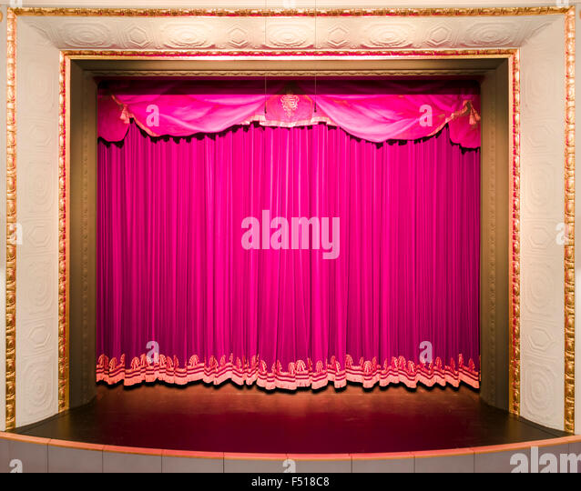 A Curtain In Purple Color Covering Theater Stage