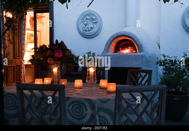 Delightful Lit Candles On Patio Table Of Country Residence   Stock Image