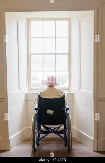 Smiling carer pushing an old man in a wheelchair stock photo image - Lady In Wheelchair Stock Photos Amp Lady In Wheelchair Stock