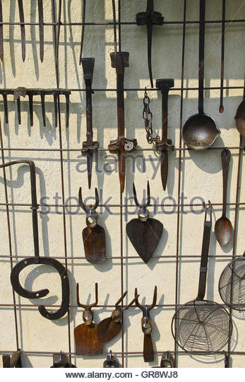 Ancient Iron Tools For Use In Garden And Kitchen On Display Italy   Stock  Image