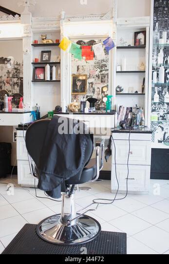 A chair in a hair salon. - Stock Image