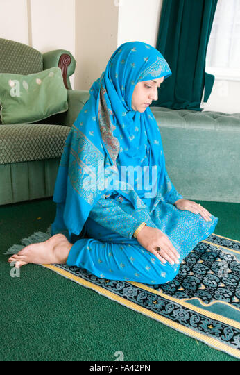 Praying On Knees Woman Stock Photos & Praying On Knees ...