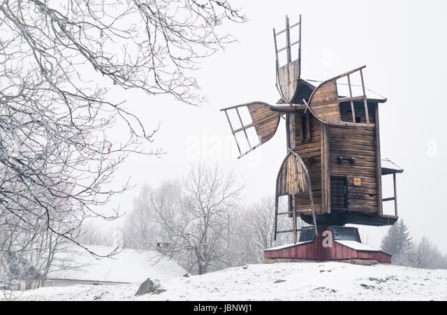 Winter landscape with old and abandoned windmill at daytime in Finland - Stock Image