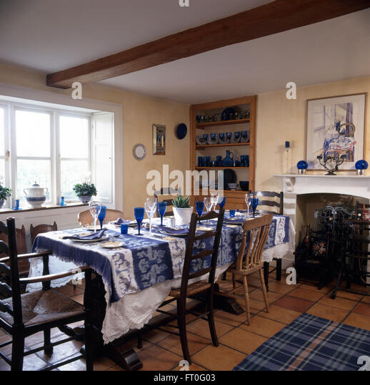 Country Settings Stock Photos amp Country Settings Stock  : blue glasses and an ikat cloth on table with mis matched chairs in ft0g03 from www.alamy.com size 518 x 540 jpeg 85kB