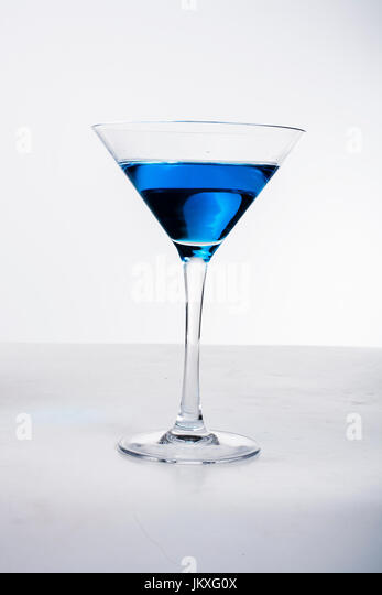 Cocktails in martini glass blue pink - Stock Image