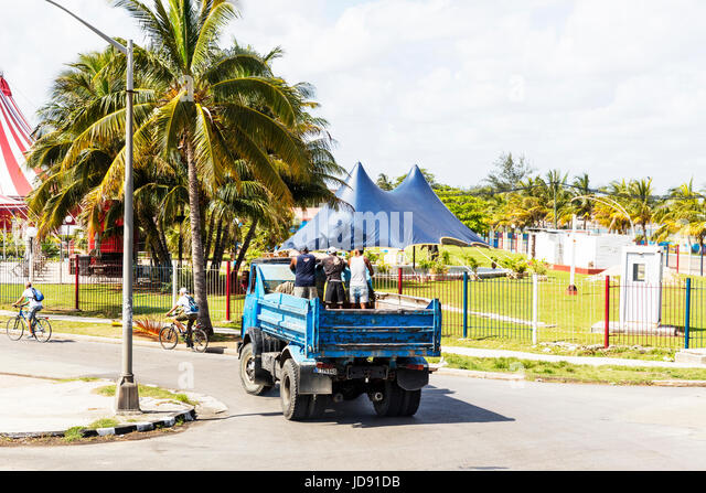 Cuban transport, people on back of truck, traveling on back of truck, cuban transportation, locals traveling on - Stock Image