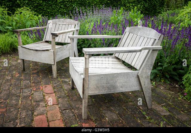 unusual oak wood garden seats in a formal english garden setting stock image - Garden Furniture Unusual