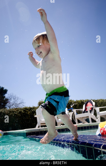 Pool party stock photos pool party stock images alamy for Kids swimming pool garden