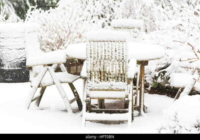 Garden In Snow   Garden Furniture, Table And Chairs Covered In Deep Snow    Stock