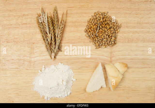 Barley Ears Barley Grains Flour And Bread On A Wooden Board Stock Image