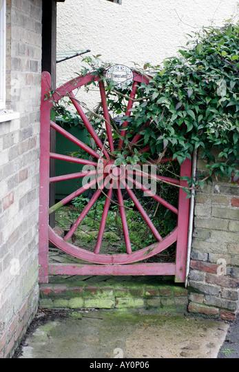 Wagon Wheel Reused As An Unusual Garden Gate   Stock Image