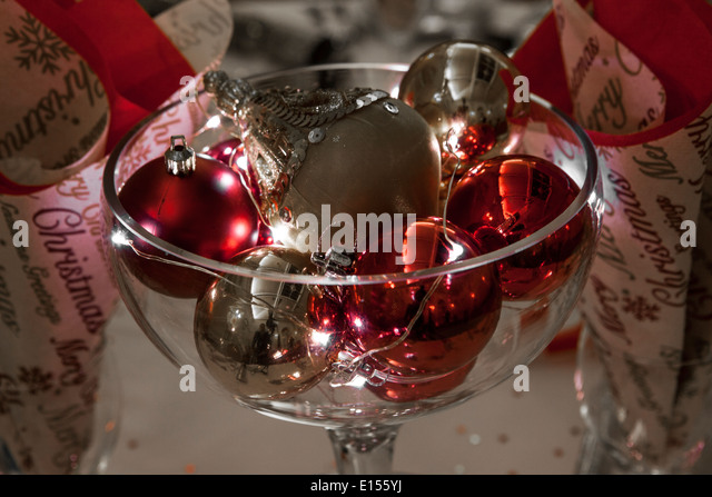 Beautiful christmas arrangement colorful baubles stock for Wine glass table decorations