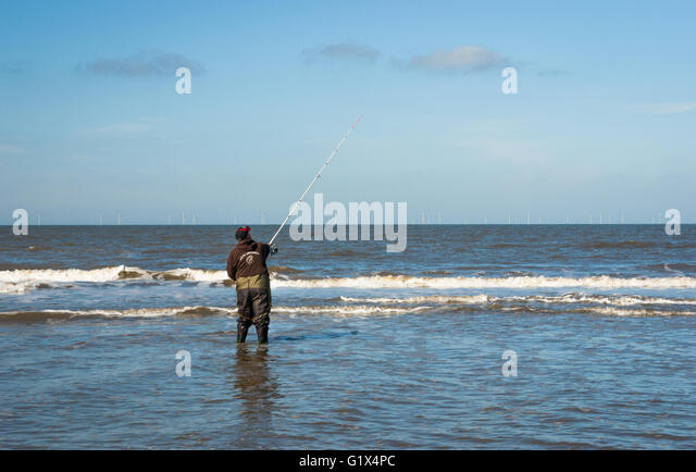 Surf fishing rod stock photos surf fishing rod stock for Surf fishing waders