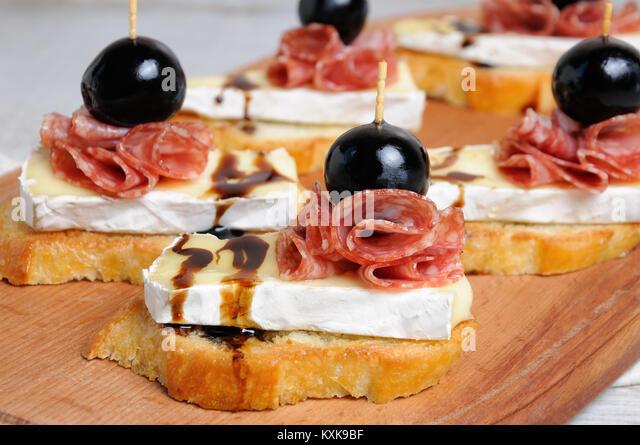 Sandwich canape salami stock photos sandwich canape for 3 piece canape bread molds