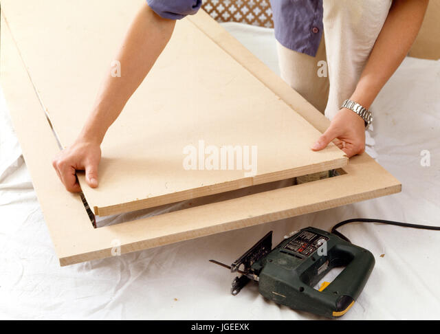 Step x step: Fitting a radiator cover - Stock Image
