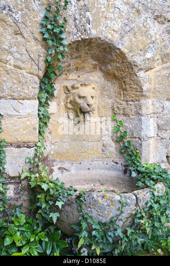 Cotswold Stone Garden Lion Head Fountain, Gloucestershire, England, UK    Stock Image