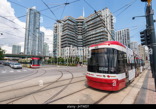 Toronto, CA - 26 June 2017: Toronto Flexity Outlook Streetcar running along the tram lines on Queens Quay W. - Stock Image