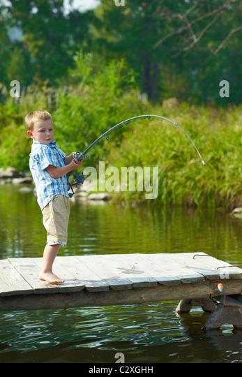 Boy fishing bait stock photos boy fishing bait stock for Little kid fishing pole