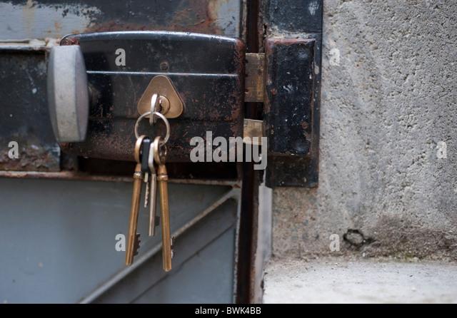 Keys In Old Metal Door Lock, Outside Residence   Stock Image