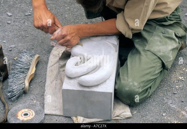 Stonemason carving stock photos