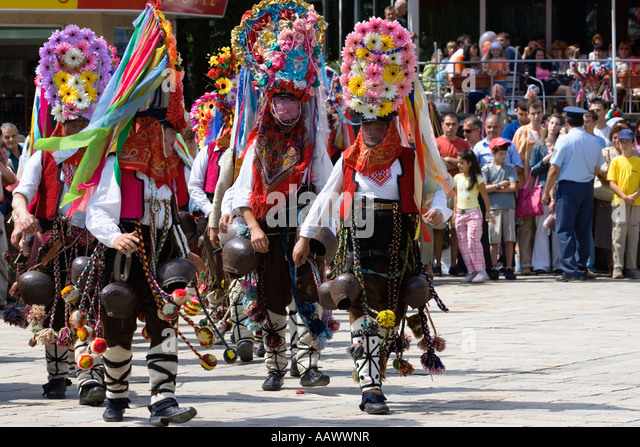 kazanlak men Bulgaria, central mountains, kazanlak, kazanlak rose festival, town produces 60% of the world's rose oil, rose parade, men in traditional rose costumes, nr male bulgarian folklore musicians performing a drums show during the traditional folklore festival '1000 national costumes'.