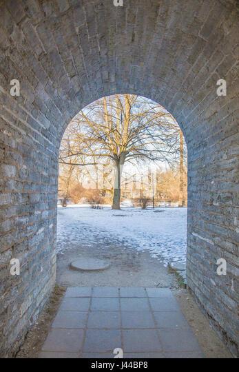 Perfect gobblestone corridor with gateway - Stock Image