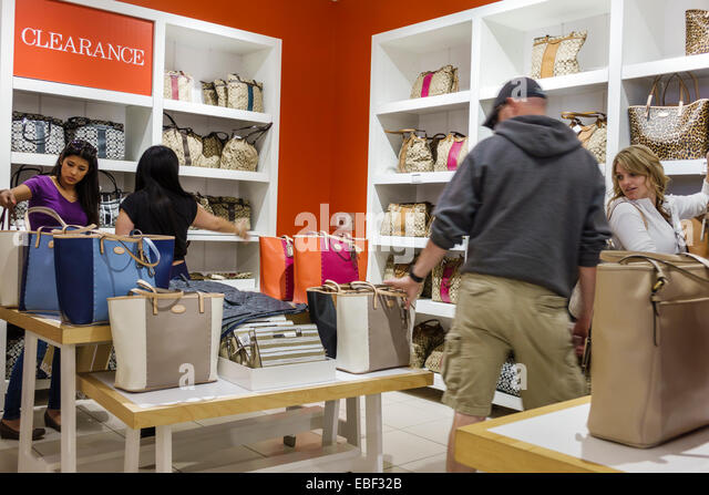 coach at premium outlets sm52  Orlando Florida Premium Outlets shopping Coach Factory leather goods  display sale women's handbags inside clearance