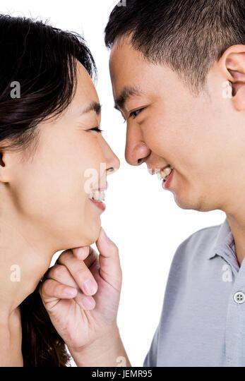 Cheerful man adoring woman - Stock Image