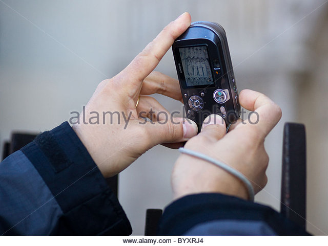 Person taking pictures with s digital compact camera - Paris France ...