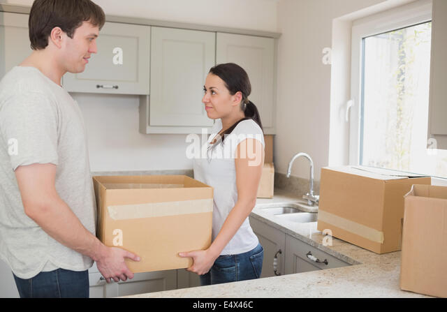 Couple kitchen delivery stock photos couple kitchen for Kitchen 17 delivery
