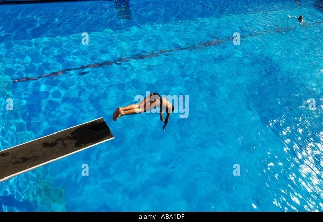 Kid Jumping Diving Board Stock Photos Kid Jumping Diving Board Stock Images Alamy